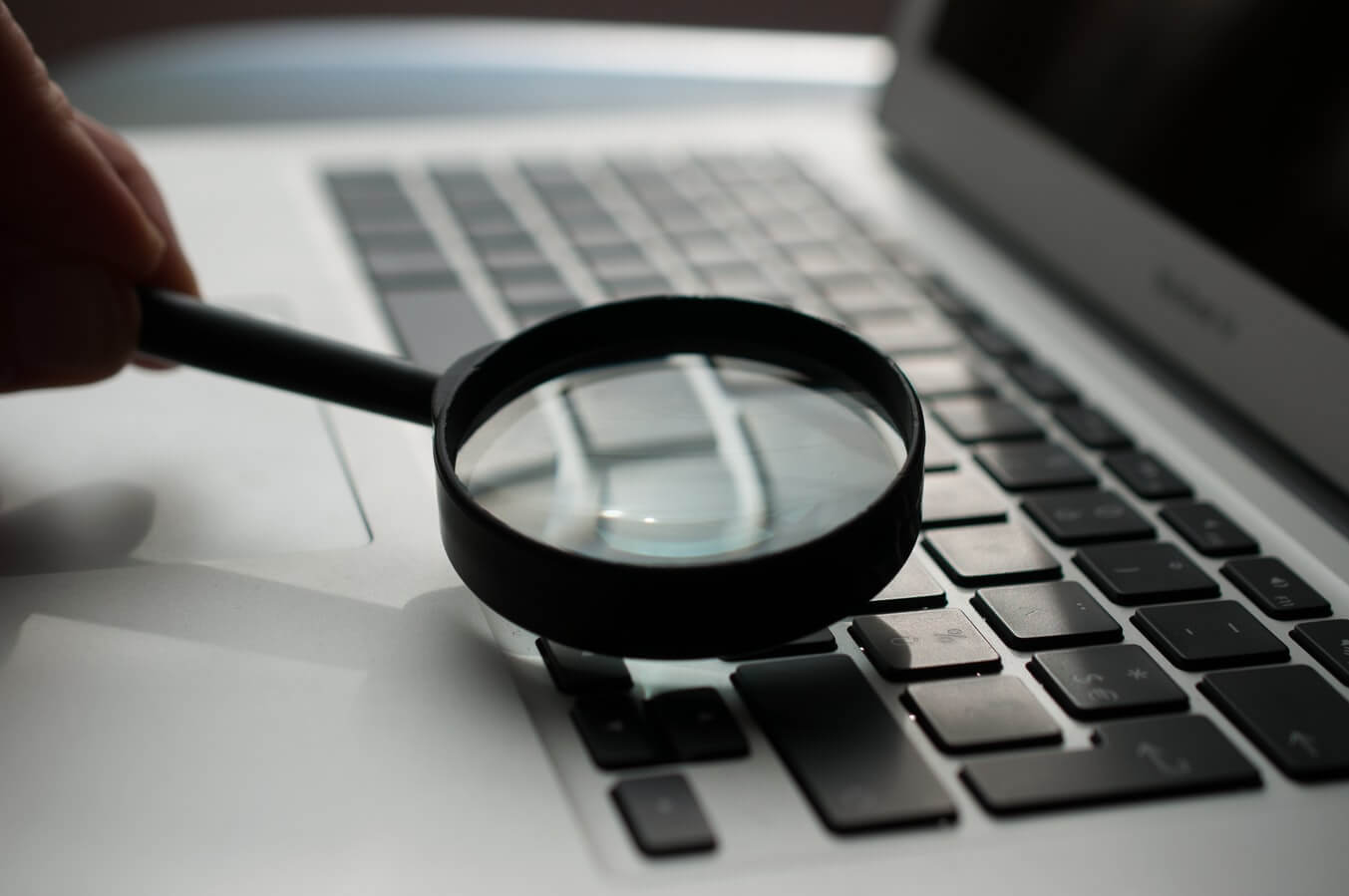 Local market research magnifying glass on laptop