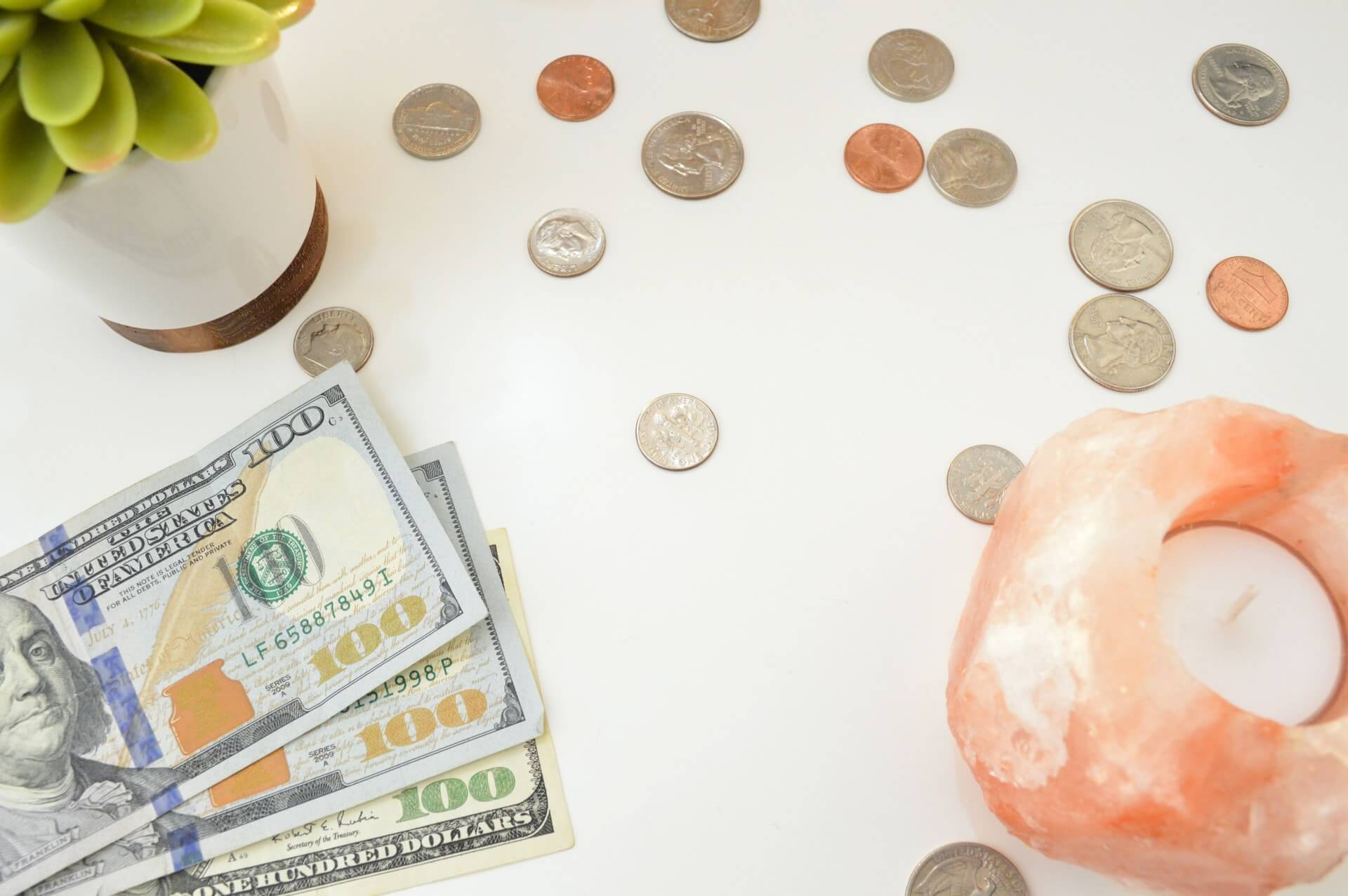 Cash and coins on a table upselling